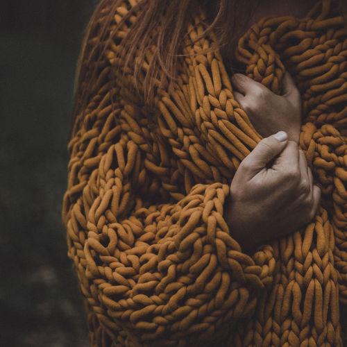 Woman in a chunky cardigan in autumn