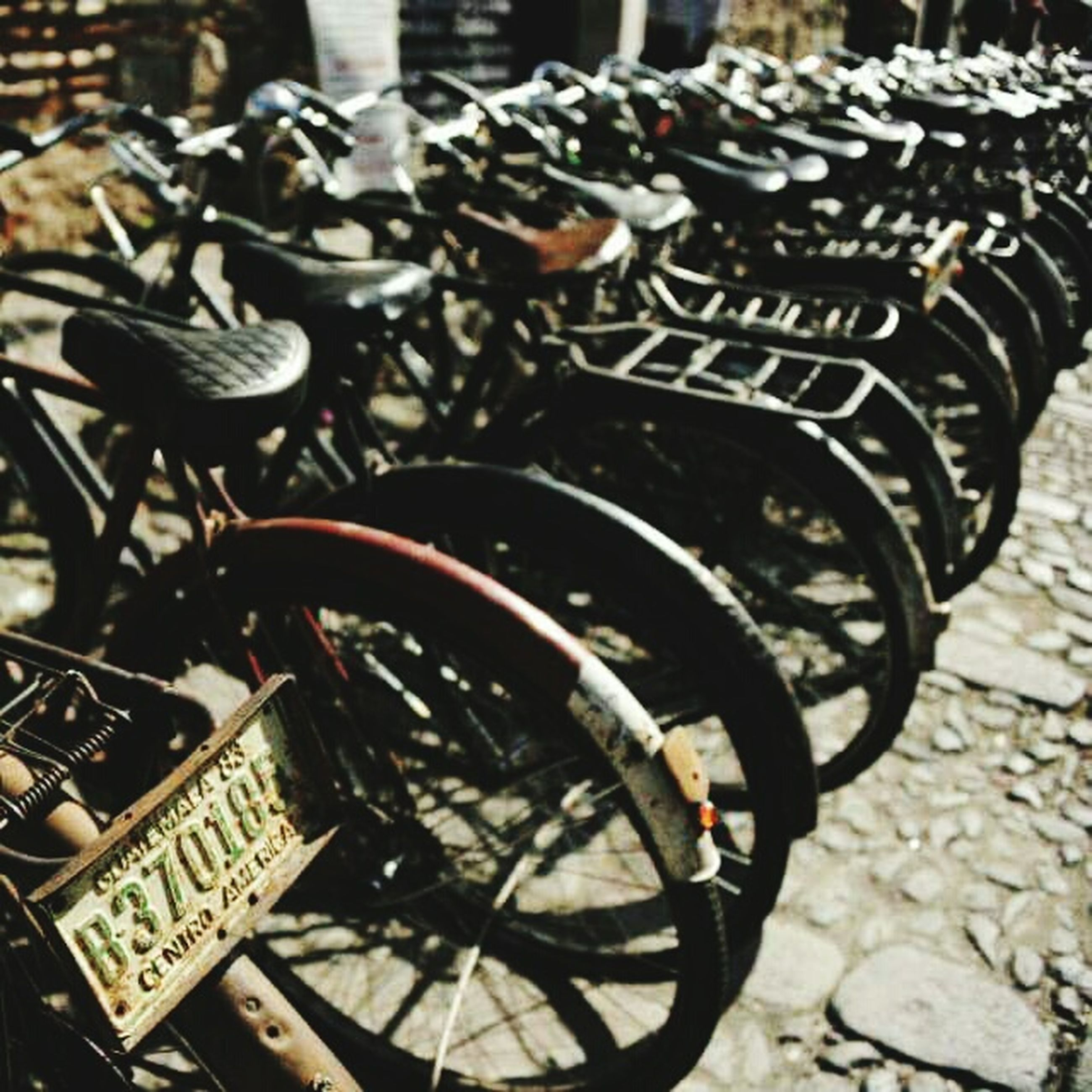metal, close-up, bicycle, metallic, focus on foreground, high angle view, still life, transportation, old-fashioned, no people, land vehicle, day, stationary, outdoors, equipment, old, part of, retro styled, wheel, parked