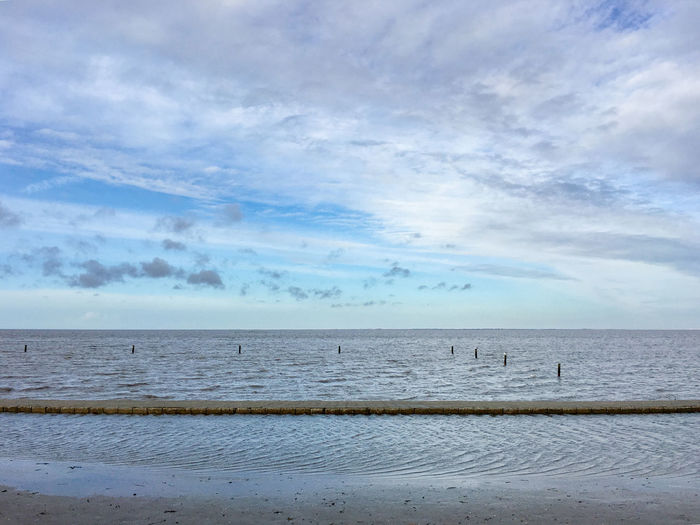 Nordseekueste, Norden-Norddeich, Germany Beach Blue Clouds Clouds And Sky Horizon Over Water Meer Nordsee Nordseeküste Ocean Outdoors Sand Sea Shore Sky Water Pastel Power