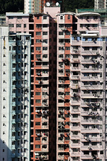 Hong Kong Apartment Architecture Backgrounds Building Building Exterior Built Structure City City Life Day Full Frame House In A Row Nature No People Outdoors Residential District Skyscraper Sunlight Tall - High Travel Destinations Window The Architect - 2018 EyeEm Awards