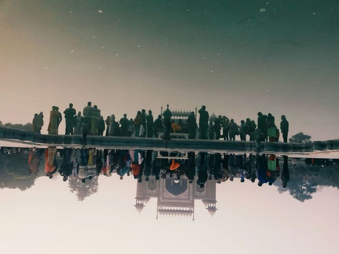Reflection of people in water