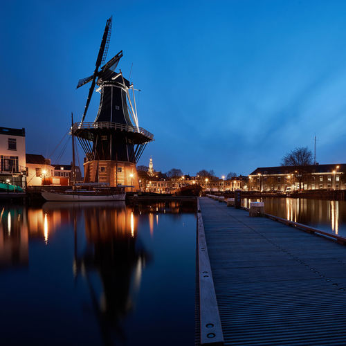 Haarlem's Finest Architecture Blue Blue Hour Built Structure Clear Sky Dusk Dutch Europe Haarlem Holland Holland❤ Jetty Long Exposure Nautical Vessel Nederland Netherlands Outdoors Reflection River Slow Shutter Twilight Water Waterfront Wide Angle Windmill