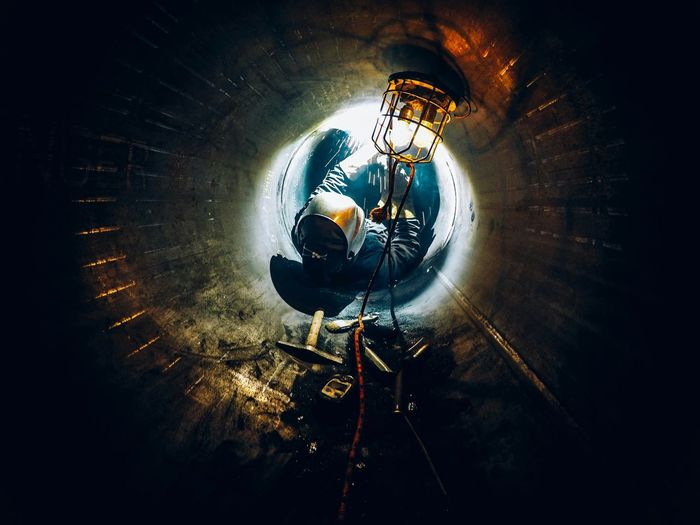 Man working in tunnel