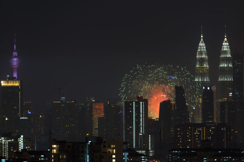 KUALA LUMPUR, MALAYSIA - 31ST AUGUST 2017; Fireworks show at Kuala Lumpur city centre during 60th Malaysia Hari Merdeka Celebration (Independence Day) Architecture Celebration Holiday KL TOWER Malaysia Truly Asia National Night Lights Noise Skyscrapers Smoke Timing Aerial Blast Building Chemistry Downtown District Firework Display Independence Day Merdeka Neon Color Peaceful Petronas Twin Towers Pyrotechnics Syncronized Urban Skyline