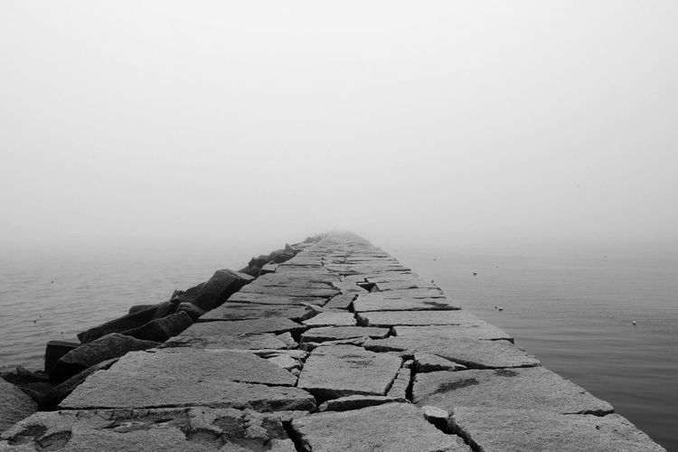 Black And White Friday Tranquility Water Nature Tranquil Scene Beauty In Nature Scenics Day Sea No People Outdoors The Way Forward Groyne Beach Horizon Over Water Sky