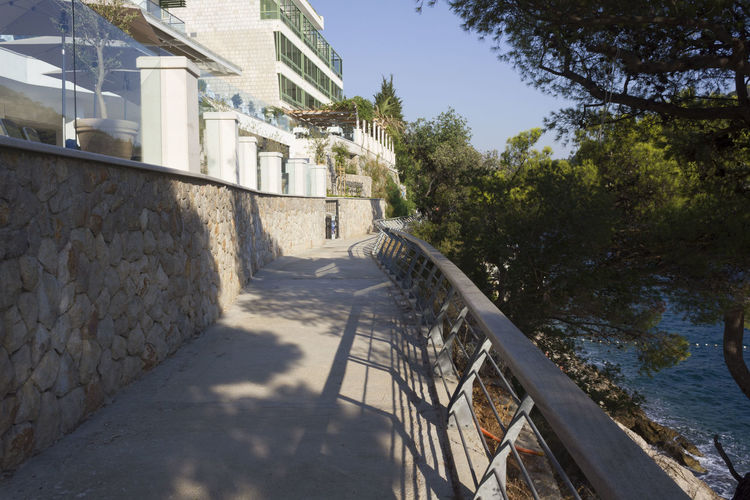 Lapad Dubrovnik Outdoors Sea Seascape Croatia Adriatic Sea Croatia ♡ Nobody Summer Architecture Built Structure Building Exterior Nature Building Sunlight Plant Tree Day Shadow Water Wall No People Sky Railing Wall - Building Feature House Direction Stone Wall