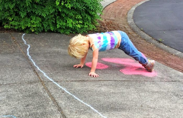 Checking to see how much chalk she's got on herself... 13048553