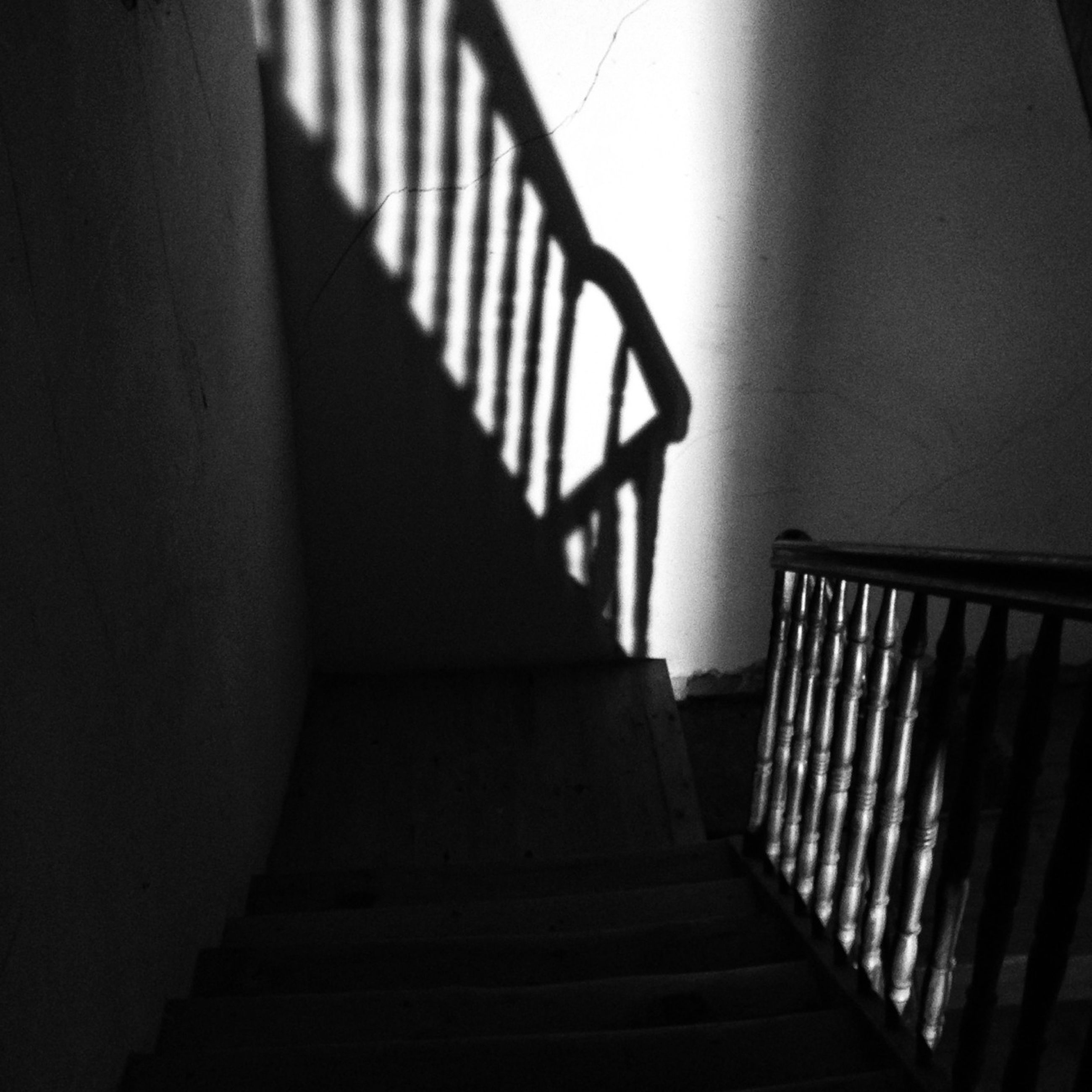 indoors, railing, staircase, steps and staircases, steps, built structure, architecture, shadow, low angle view, sunlight, wall - building feature, home interior, stairs, absence, empty, no people, building, the way forward, house, close-up