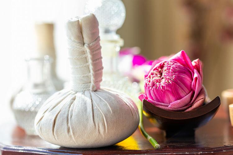 Hot compress massage. spa compress ball and lotus flower.