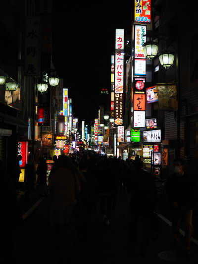 Advertisement Architecture Building Exterior Built Structure City Communication Illuminated Large Group Of People Multi Colored Neon Night Outdoors People Real People Shinjuku Tar Text Tokyo Tokyo Night Travel Destinations