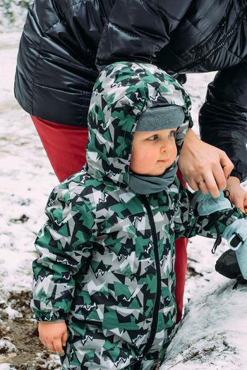 Full length of boy on snow covered land