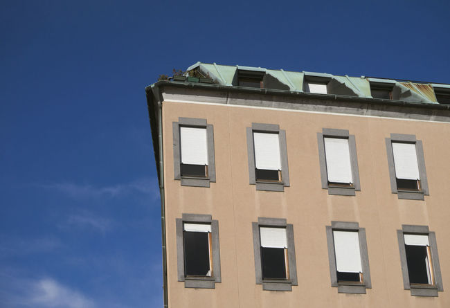 residential building corner, Italy Edge Part Of Architecture Blue Building Exterior Built Structure Clear Sky Corner Day Housing Mansard Mansard Roof No People Outdoors Residential Building Sky Window Windows