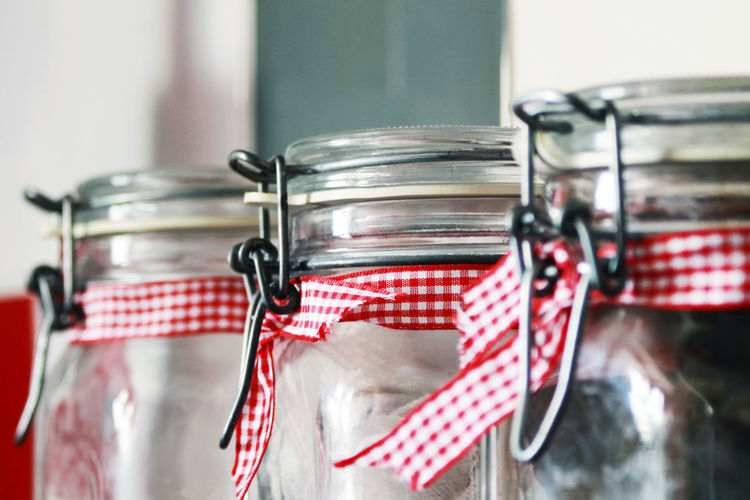 Kitchen jars with red ribbons. Coffee Red Ribbon Tea Clip Close-up Day Focus On Foreground Glass Glass - Material Indoors  Jar Jardin Jars  Kitchen Metal No People Red Selective Focus Silver Colored Still Life Striped Wall - Building Feature
