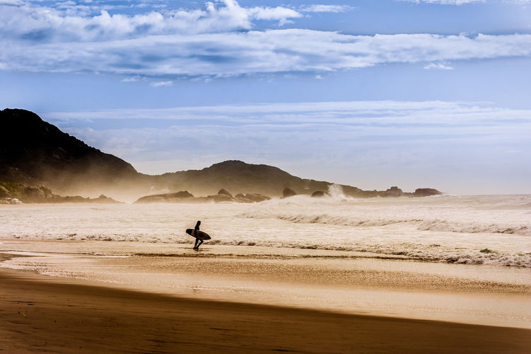 Dawn Patrol Surfing Beach Beauty In Nature Day Extreme Sports Nature One Man Only Outdoors Praia Mole Sand Sea Sky Sport Sunrise Surf Surfing Water