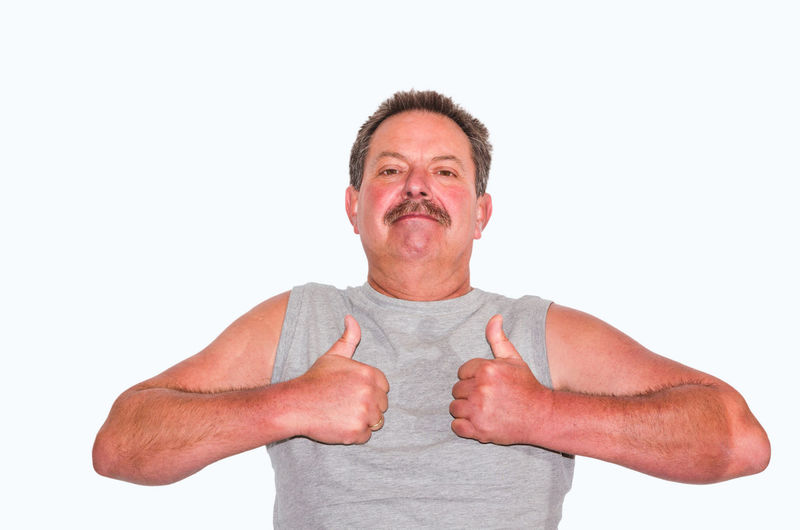 Portrait of man showing thumbs up