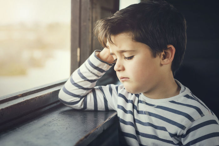 Angry Innocence Loneliness Lonely Reflection Boredom Child Childhood Close-up Crying Crying Child Distressed Elementary Age Expression Headshot Nostalgic  Orphan People Sad Sadness Serious Shyness Tears