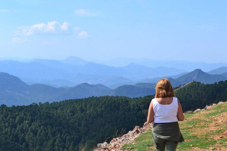 Mirando Mountain Scenics - Nature Leisure Activity Beauty In Nature Rear View Real People Mountain Range