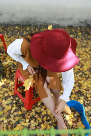 Side view of a girl wearing hat