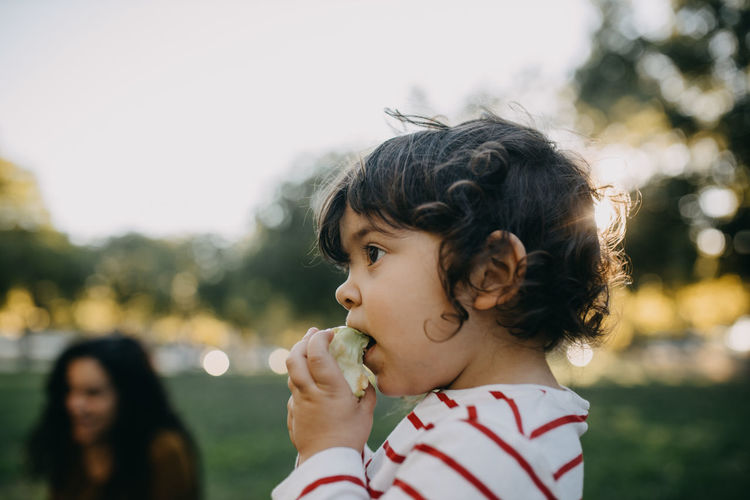 Close-up portrait of girl eating food