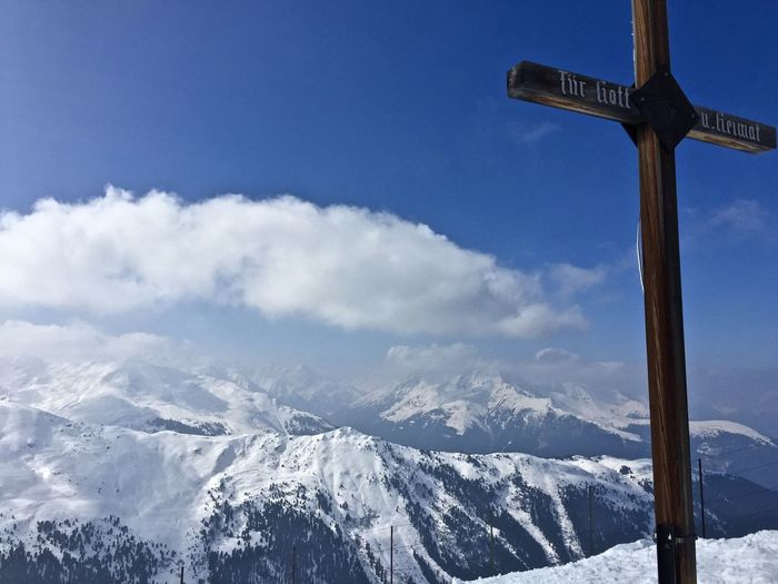Scenic view of cross against snow covered mountain