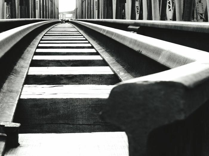 Close-Up Of Railroad Tracks On Railway Bridge