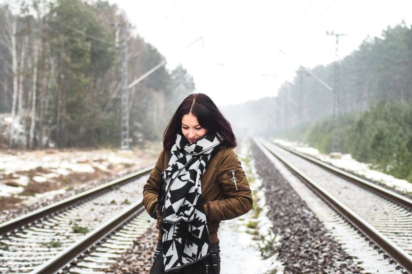 Woman on train tracks Railroad Track Rail Transportation Transportation Train - Vehicle One Person Railroad Station Platform Day Public Transportation Railroad Station Outdoors Railroad Tie Real People Railroad Tree Nature Electricity Pylon Young Adult Beauty In Nature Sky Steam Train