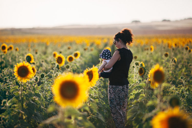 Field Mother Mother & Daughter Motherhood Sunflower Alentejo Beauty In Nature Field Flower Flower Head Flowering Plant Growth Hairstyle Land Leisure Activity Lifestyles Nature Plant Standing Sunflower Sunflowers Sunflowers🌻 Sunflower🌻 Yellow Young Women