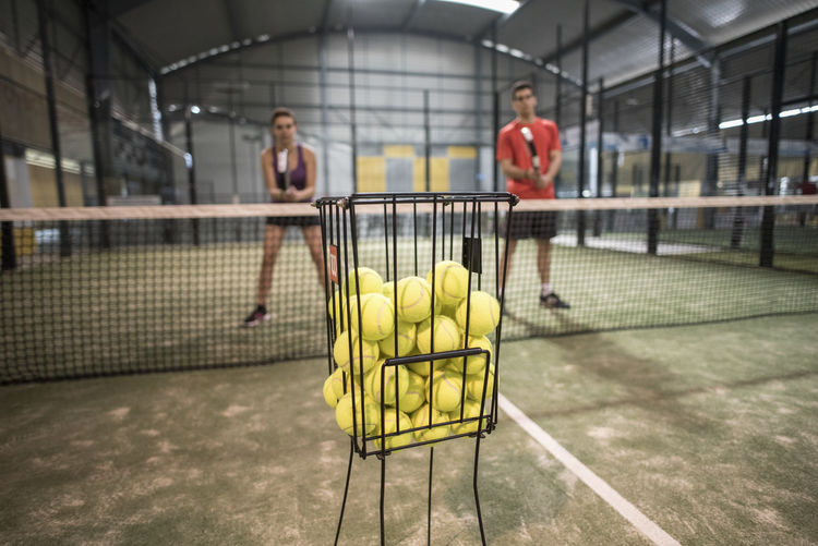 Paddle tennis play. Backgrounds Basketball Court Day Full Length Growth Indoor Indoors  Indoors  Men Motion Paddle Tennis Paddle-tennis Pattern Plant Real People Sport Sports Sports Clothing Tennis Togetherness Training Tree Two People Women