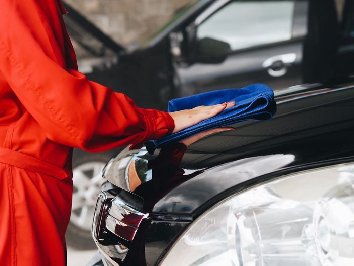 Woman worker washing car. Car Day Focus On Foreground Hand Holding Human Body Part Human Hand Land Vehicle Lifestyles Men Midsection Mode Of Transportation Motor Vehicle One Person Outdoors Real People Red Transportation Travel