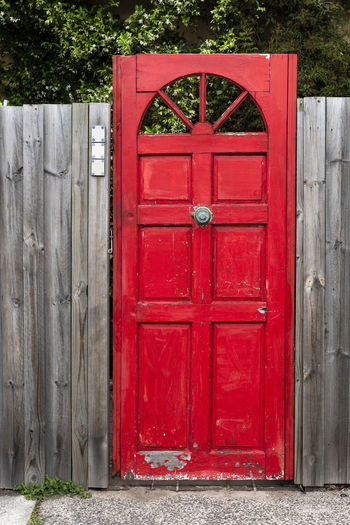 The red door Red Door Entrance Security Closed Wood - Material Day Protection Safety Architecture No People Built Structure Building Exterior Outdoors Building City Gate Vibrant Color