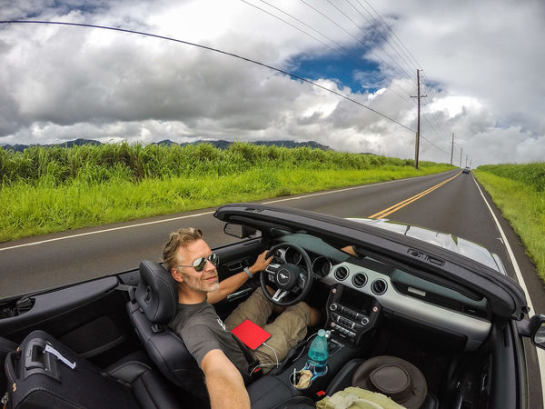 Driving the north shore of Oahu Adult Convertible Cruisin Driving Ford Ford Mustang Having Fun Hawaii Mustang Oahu On The Road One Man Only One Person Open Top Outdoors People Real People Roadtrip Self Portrait Sky Sports Car The Drive Transportation USA Second Acts