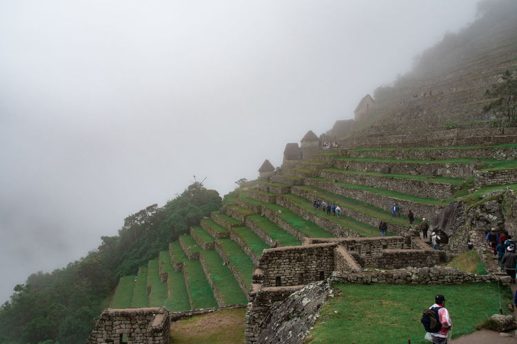 Fog Ancient History Architecture Nature The Past Ancient Civilization Sky Travel Destinations Tourism Day Plant Travel Built Structure Incidental People Mountain Old Ruin Real People Outdoors Archaeology Machu Picchu Inca Inca Ruins