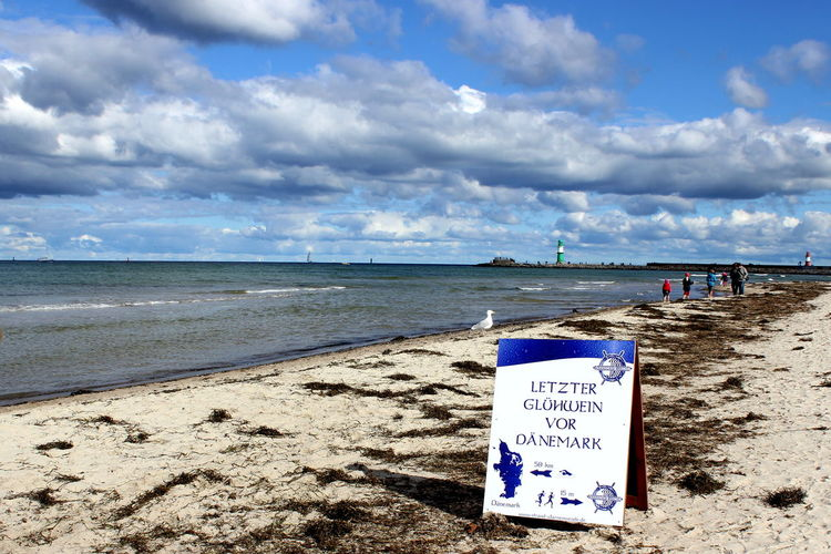 Baltic Sea Beach Beauty In Nature Blue Cloud Cloud - Sky Cloudy Coastline Horizon Over Water Idyllic Information Sign Nature Non-urban Scene Outdoors Remote Sand Scenics Sea Shore Sky Tranquil Scene Tranquility Vacations Warnemünde Baltic Se Water