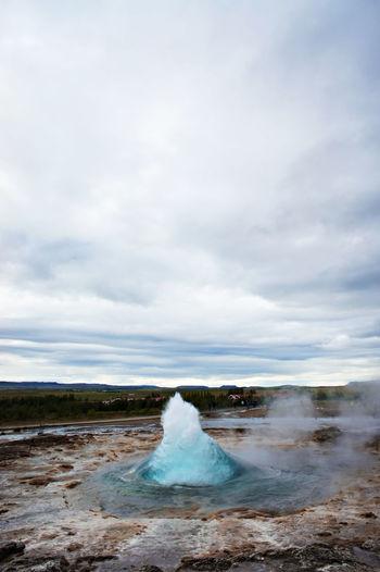 The great geysir, geyser in southwestern iceland, haukadalur valley, geyser splashing out of ground