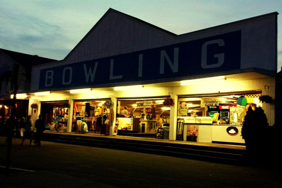 Store Built Structure Architecture Illuminated Building Exterior Nightlife Travel Destinations Outdoors Bowling Hampton Beach Beach Boardwalk New Hampshire Retail  Arts Culture And Entertainment Night Sky People Paint The Town Yellow Stories From The City
