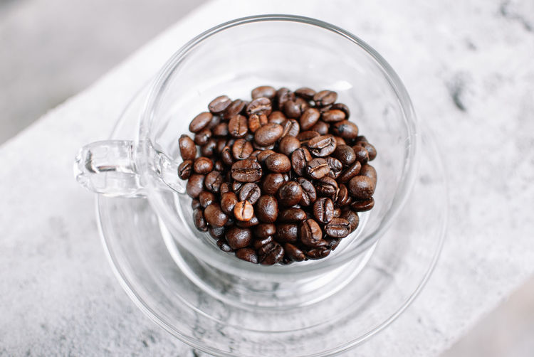 Food And Drink Food Roasted Coffee Bean Coffee Freshness Large Group Of Objects Coffee - Drink Brown Indoors  No People Close-up Still Life Glass - Material Table High Angle View Jar Container Drink Abundance Transparent Glass Caffeine