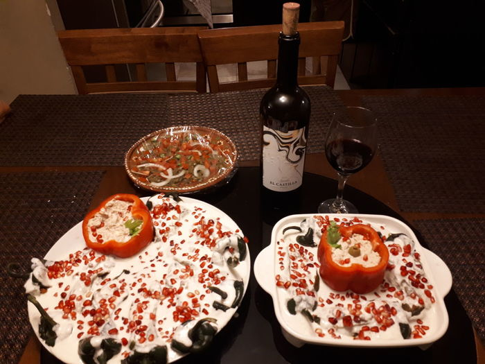 chiles en nogada Mexican Food High Angle View Celebration Food And Drink Close-up Red Wine Served Wineglass
