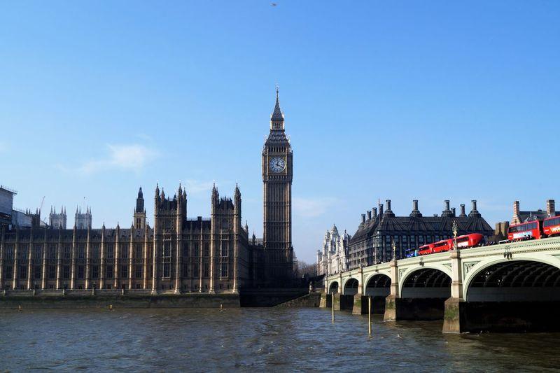 Westminster bridge over thames river against clear sky