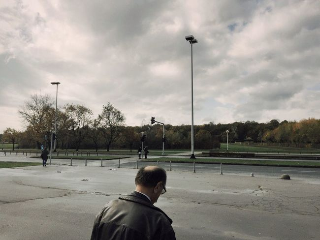 Gloomy weather over Dubrava, everybody contemplating lost in their thoughts, Zagreb, Croatia, 2016. Dubrava Zagreb Croatia Street Photography Gloomy Rainy Day Clouds Rear View Back VOID Road Street