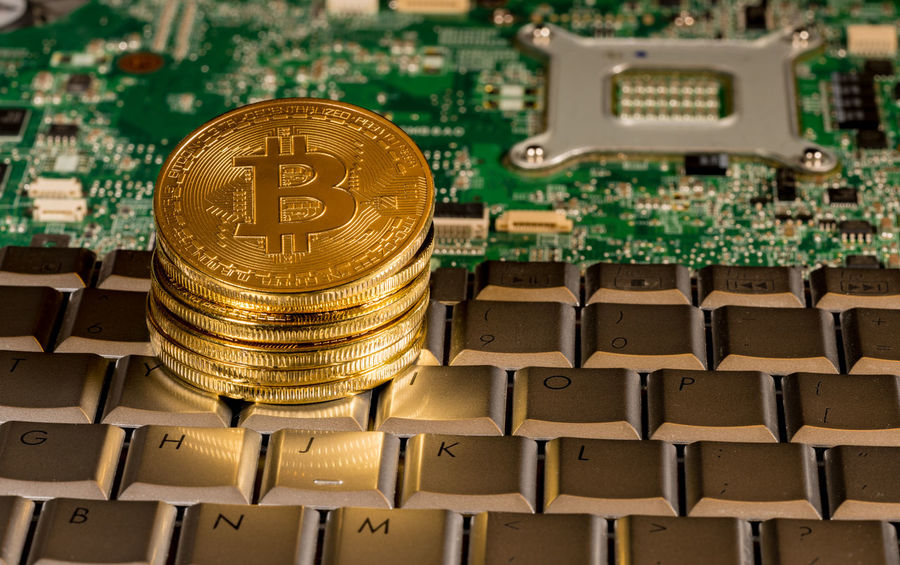 Bitcoin coins on computer equipment to illustrate mining for new cybercurrency Currency Trading Bitcoin Bitcoin Mining Blockchain Coin Coins Computer Cybercurrency Finance Financial Technology