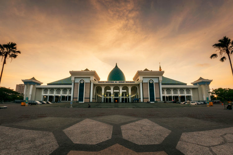 Facade Of Mosque Against Sky During Sunset