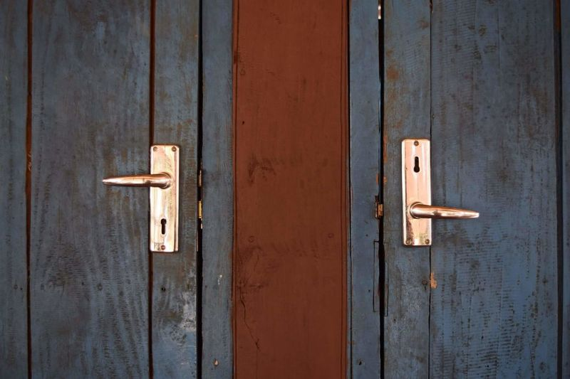 Close-Up Of Closed Wooden Doors