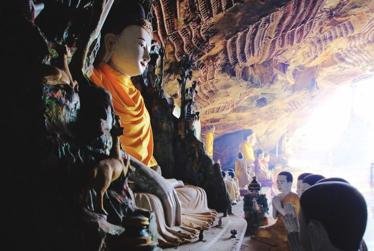 Hpa-An Buddha Statue Myanmar Sun Beams Cave Hpa-an Sculpture Architecture Representation Art And Craft Statue Human Representation Creativity Illuminated Belief Religion Spirituality Place Of Worship