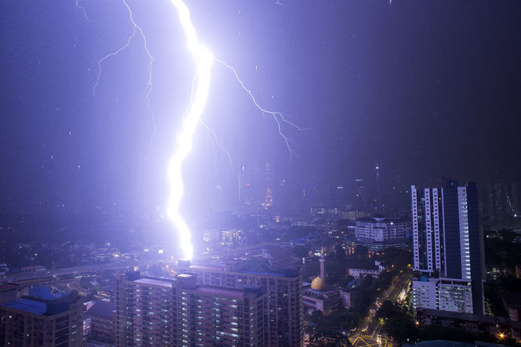 Lightning Strike In Kuala Lumpur, Malaysia Lightning City Cityscape Night Building Exterior Power In Nature Storm Sky Architecture Built Structure Thunderstorm Cloud - Sky Power Illuminated Building City Life Skyscraper No People Office Building Exterior Nature Outdoors Modern Dark Light My Best Photo
