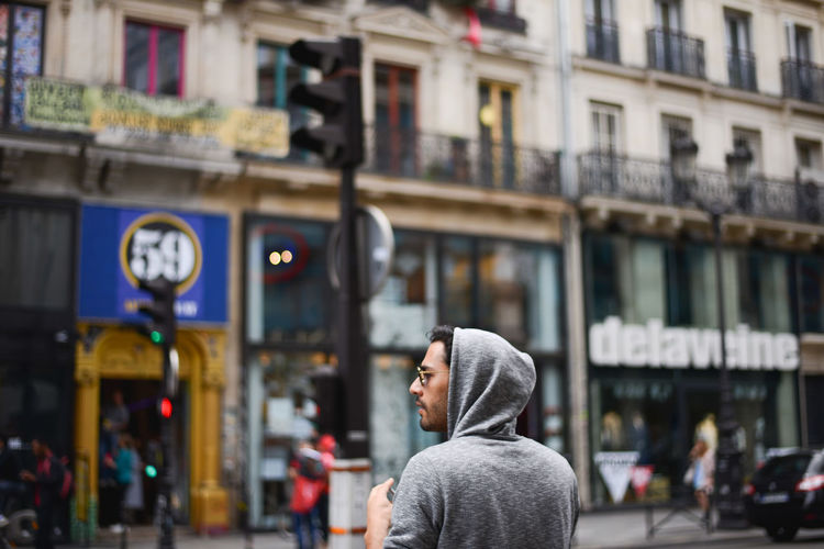 Too cool to show his haircut! Architecture Building Exterior Built Structure City Focus On Foreground France French French People Men Montmartre One Person Paris People Real People Rear View Snap a Stranger Strange Street Street Art Street Photography Streetphotography The Photojournalist - 2017 EyeEm Awards The Street Photographer - 2017 EyeEm Awards Waling Around Walking By The Street Photographer - 2018 EyeEm Awards