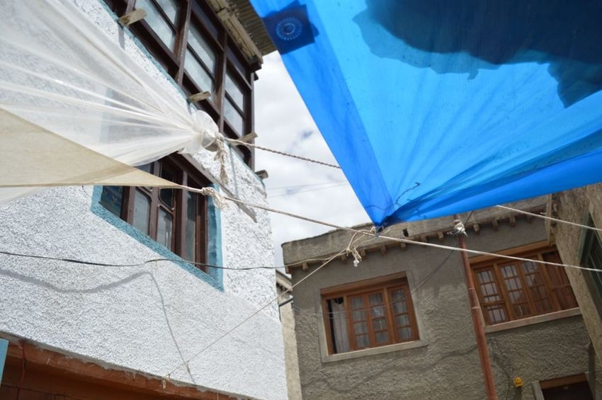 Snapshots from Leh City, August 2016. Leh City Architecture Blueandwhite Building Building Exterior Built Structure City Cityexplorer Close-up Day Detail Details Details Textures And Shapes LehLadakh Lehladakhtrip Low Angle View No People Old Town Outdoors Sheets Sheetsforsun Sky Suncover