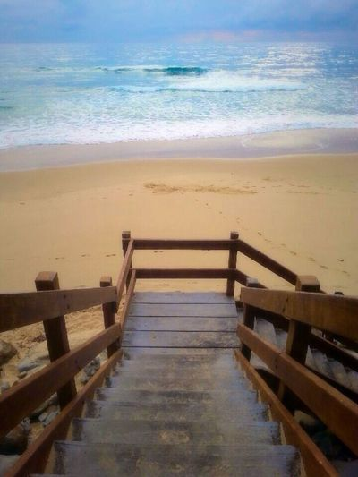 Beach Water Sea Shore Sand Horizon Over Water High Angle View Railing Tranquil Scene Steps Scenics Wave Calm Tranquility Coastline Outdoors Nature Beauty In Nature Non-urban Scene Sky
