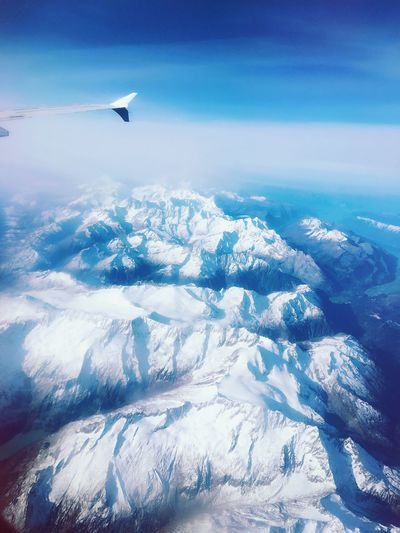Over The Sky Airplane Flying Nature Landscape Alps No People Beauty In Nature Airplane Wing Day Aerial View Sky Outdoors Aircraft Wing Cold Temperature Transportation Mid-air Blue