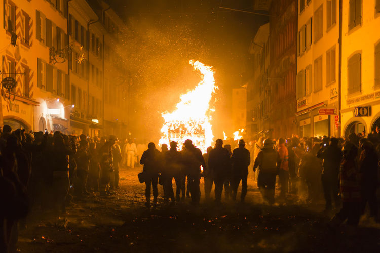 Chienbaese festival. Switzerland, Liestal, Rathausstrasse 25, 18th of February 2018. Festival participants pulling a wagon stacked with burning wood through the old town. Burning Flames Old Town Smoke Tourist Attraction  Tradition Wagon  Arts Culture And Entertainment Burning Crowd Culture Danger Festival Fire Fire - Natural Phenomenon Group Of People Heat - Temperature Liestal Night Outdoors Parade Real People Swiss Switzerland Wood - Material
