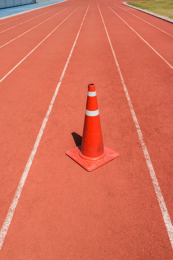 High angle view of traffic cone on running track